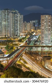 Residential buildings and highway in Hong Kong at night