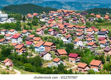 Residential buildings and houses in charming hilly landscape, aerial view, Europe