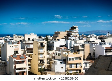 Residential buildings and sea against cloudy sky, Heraklion, Greece