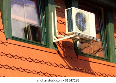 A residential central air conditioning unit hanging outside a home