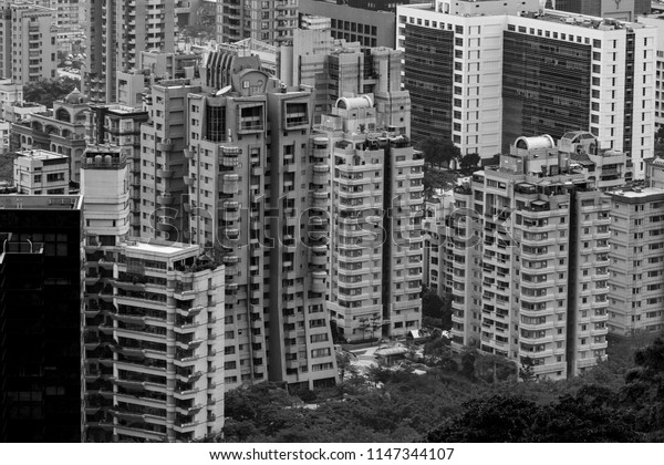 Residential and Commercial buildings in Taipei, Taiwan. Miscellaneous city skyscrapers, black and white image. Cluster of tall buildings in the heart of the city. Densely populated Taipei district