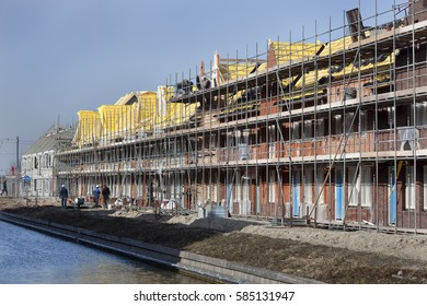 Residential construction site with some workers in Berkel in the Netherlands