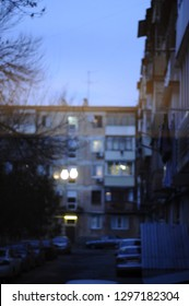 Residential courtyard. Evening city lights. Vitage buildings. Window view. Cold balans.