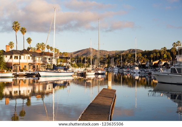 Residential development by water in Ventura California with modern homes and yachts boats