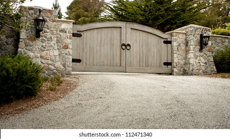 A residential entry gate and driveway.