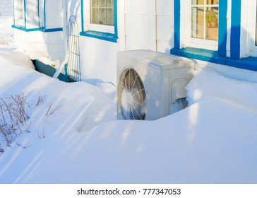 Residential heat pump in a snow bank.