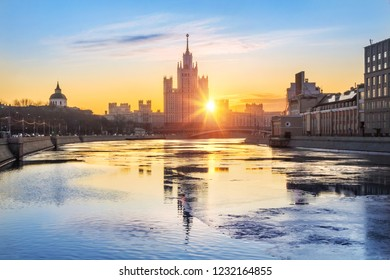 Residential high-rise building on Kotelnicheskaya Embankment in Moscow with reflection in the Moscow River in the early morning