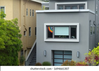 Residential home displaying paper rainbow on their front windows to encourage hope and love during the Coronavirus Pandemic. April 5, 2020, San Francisco, CA.