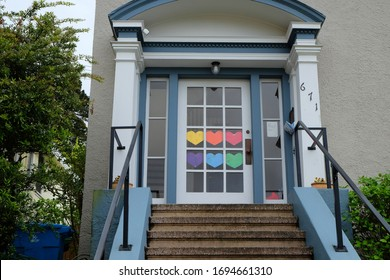 Residential home displaying paper rainbow hearts on their front door to encourage hope and love during the Coronavirus Pandemic. April 5, 2020, San Francisco, CA.