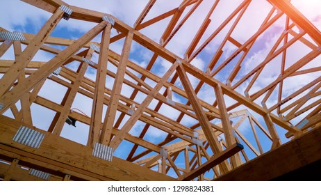 Residential home framing view on new house wooden under construction
