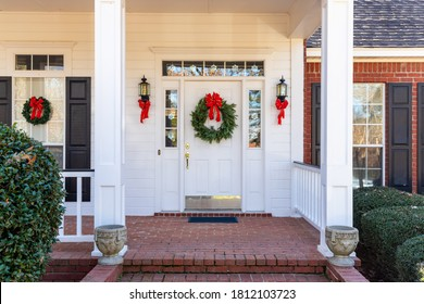 Residential home front door decorated for Christmas - Shutterstock ID 1812103723