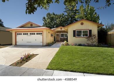residential home,garage,front door,bedroom,lawn and sandstone driveway