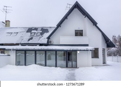 Residential house in frosty winter time covered with snow