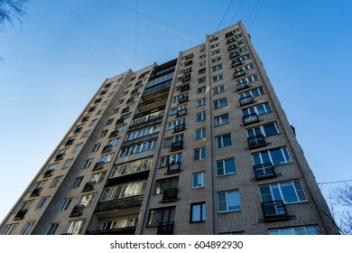 residential house on blue sky background. Block of flats from soviet times