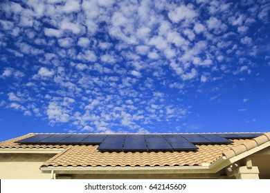 Residential House Rooftop Solar Panels with a Blue Sky
