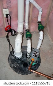 Residential House, Sioux Falls, South Dakota, USA - 6/12/2018: sump pump manhole with water backup and radon mitigation