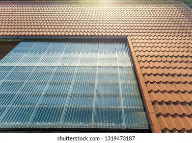 Residential house with tin roof and transparent corrugated sheets as terrace roofing