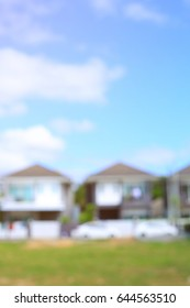 residential house village suburb with grass field playground, image blur background