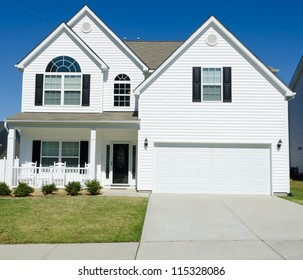 Residential house with white vinyl siding