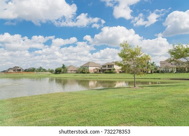 Residential houses by the lake in Pearland, Texas, USA.