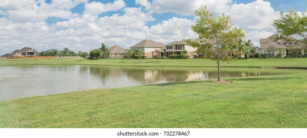 Residential houses by the lake in Pearland, Texas, USA. Panorama style.