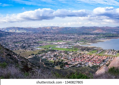 Residential houses in a valley by the lake with mountains on the background. Panoramic view on the city of Lake Elsinore, Southern California USA.