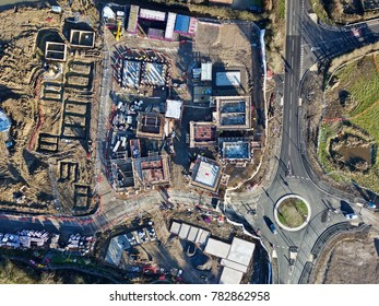 Residential housing development industrial building site road roundabout aerial photo