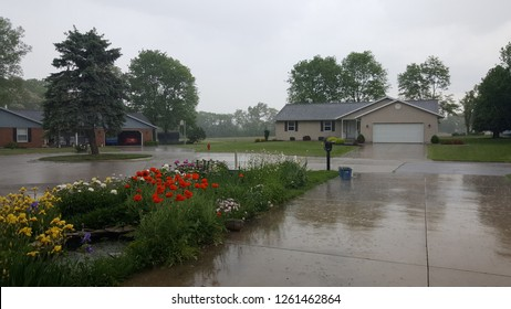 Residential Neighborhood cul de sac in summer during a thunderstorm rainstorm