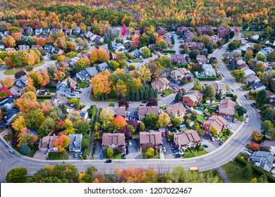 Residential neighbourhood in the suburbs of Montreal during autumn season in Quebec, Canada, aerial view.