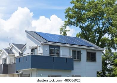 Residential new home solar panel sunny blue sky green