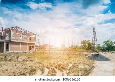 Residential new house building at construction site with clouds and blue sky