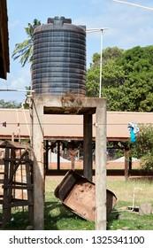 Residential Plastic Water Supply tank on elevated platform in Lethem Guyana