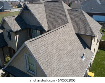 Residential shingle roof using ridge vent s with gables visible