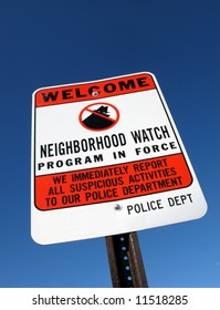 Residential suburb American neighborhood crime watch local police warning street sign over blue sky