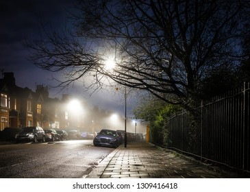 Residential suburb in the foggy night, London