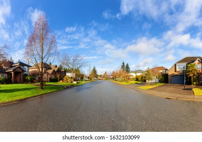 Residential Suburban Neighborhood in the City during a vibrant winter sunrise. Taken in Fraser Heights, Surrey, Vancouver, BC, Canada. Wide Angle