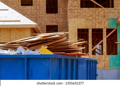 Residential view of new houses being built and construction garbage