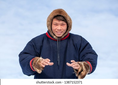 Residents of the far north,  the pasture of Nenets people, the dwelling of the peoples of the north of Yamal, close-up portrait of Nenets in national clothes of the peoples of the far north