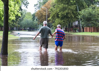 Residents of Houston suburb walk in high waters. Heavy rains from hurricane Harvey caused dangerous floods in many residential areas around Houston