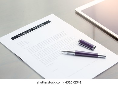 Resignation letter information with pen.