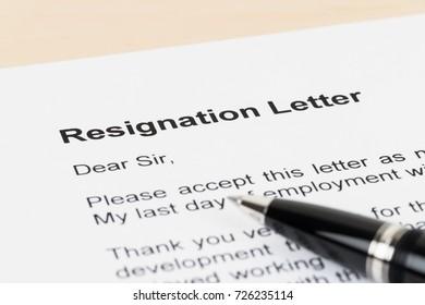 Resignation letter resign with pen