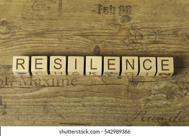 resilence word on cubes on wooden background