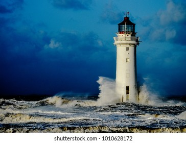 A resilient lighthouse standing up to crashing waves during a storm