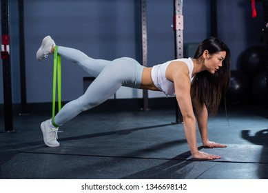 Resistance band exercises with fabric elastic equipment. Asian fitness woman