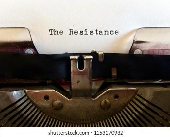 The Resistance, title heading typewritten in black ink on vintage obsolete old fashioned typewriter machine