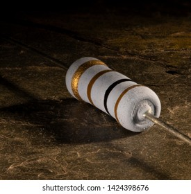 Resistor that is 100 ohms on a stone background