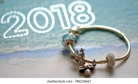 Resolution concept for year 2018. Charms with travel's idea on the light blue background