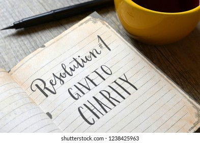 RESOLUTION No. 1 : GIVE TO CHARITY written in notebook