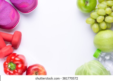 Resolutions eat healthy, lose weight and join gym, fresh fruits, dumbbells for fitness and tape measure, healthy lifestyle
