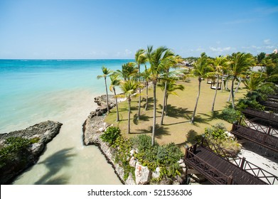 Resort at Atlantic ocean in Punta Cana with turquoise water and palms on the shore, Dominican Republic